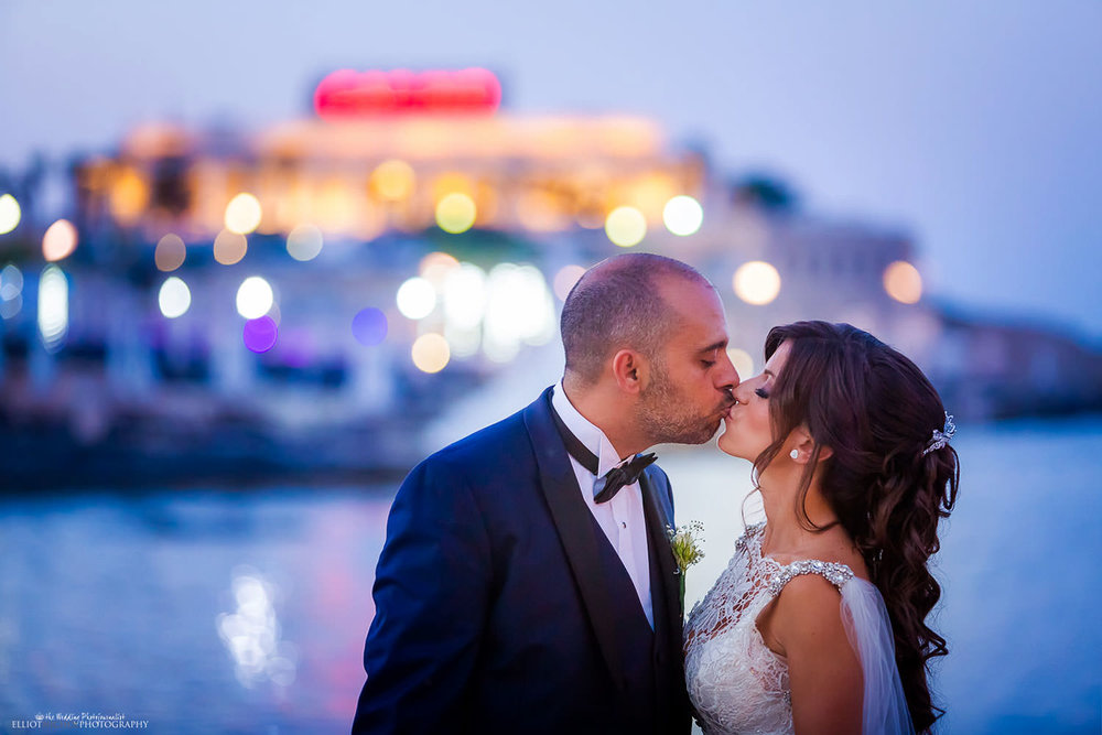 Portrait of Bride and Groom next to the casino in St Julians, Malta.
