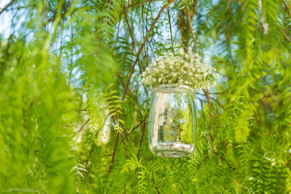 Wedding decoration in jar placed in trees at Villa Bologna in Malta.
