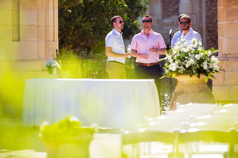 Wedding guests in the Baroque garden at Villa Bologna, Malta.