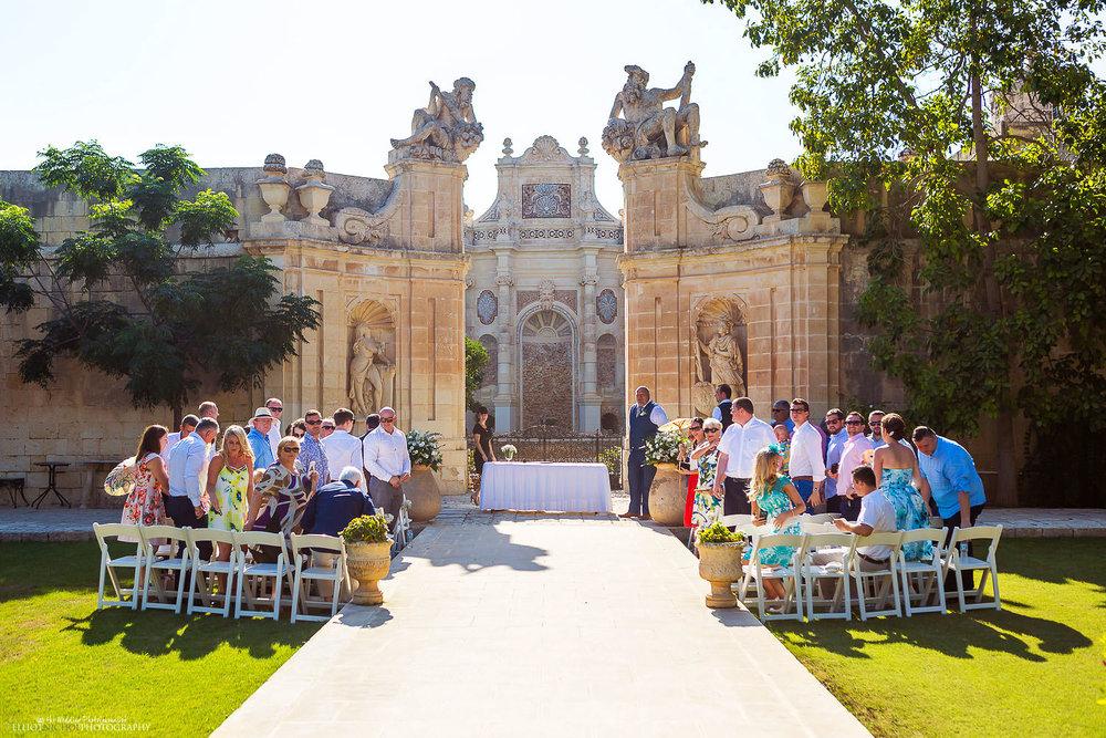 Wedding ceremony setup in the Baroque gardens at Villa Bologna, Attard, Malta.