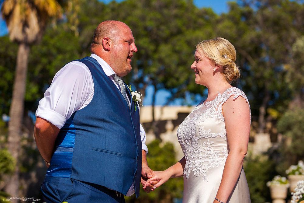 Groom repeating his vows to this bride at Villa Bologna, Malta.