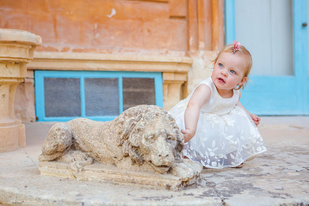 Young flower girl with Villa bologna lion statue.