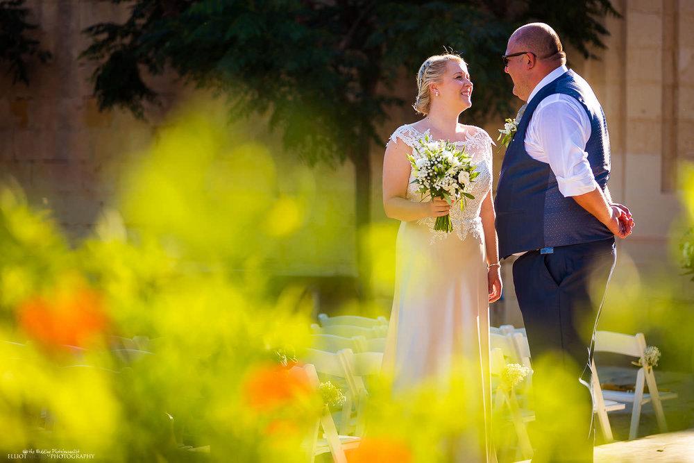 Bride and groom in the Baroque gardens at Villa Bologna, Malta.