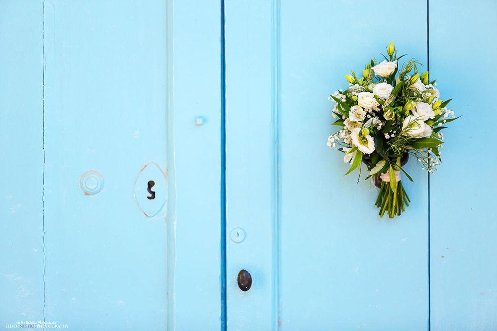 bridal bouquet on the blue doors of Villa Bologna.