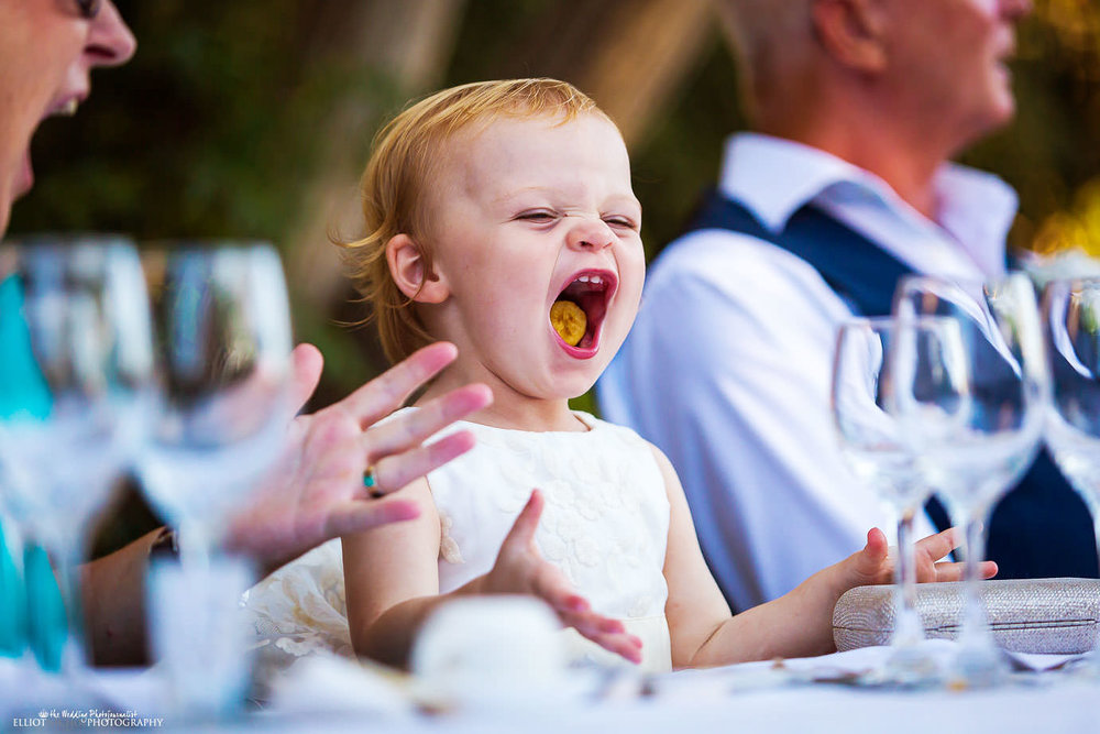 flower girl laughing during the wedding reception
