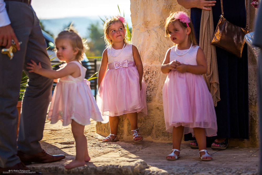 Flower girls waiting outside church for bride to arrive in Naxxar, Malta