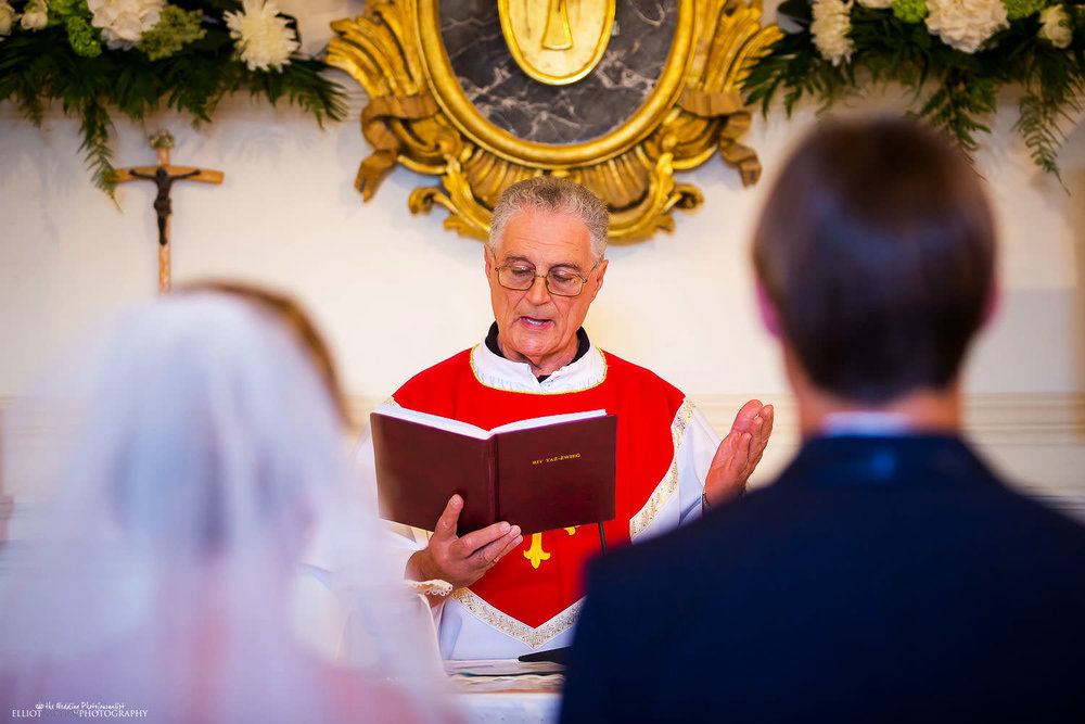 Priest during the wedding ceremony at St Pauls Chapel, Naxxar, Malta.