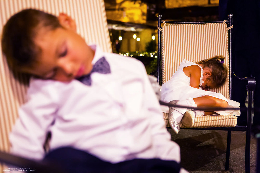 exhusted young wedding guests taking time out of the partying