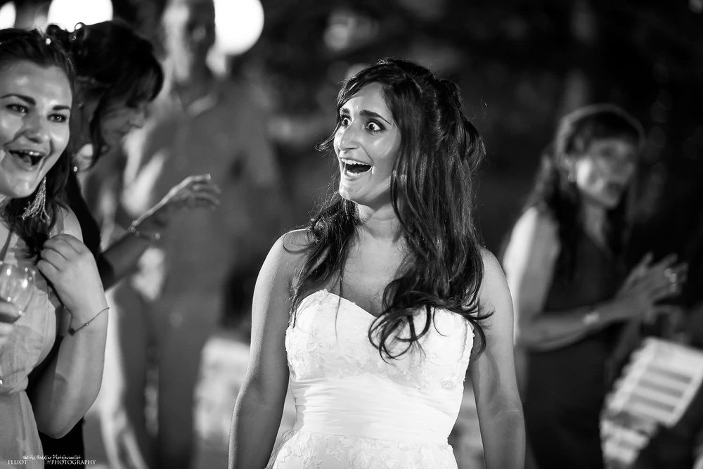 Brides surprise during her wedding reception - Mdina, Malta wedding photography