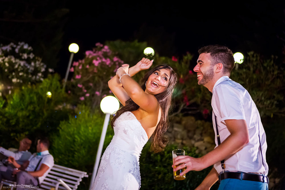 Bride and groom dancing together at their wedding reception at the Olive Gardens, Malta