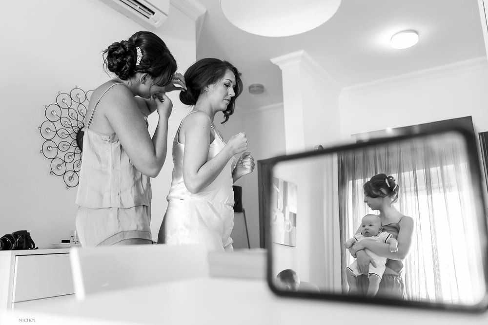 bride getting ready with her bridal party.