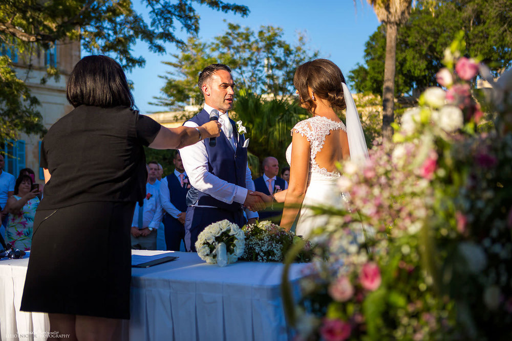 Vows during wedding ceremony at Villa Bologna, Attard, Malta.