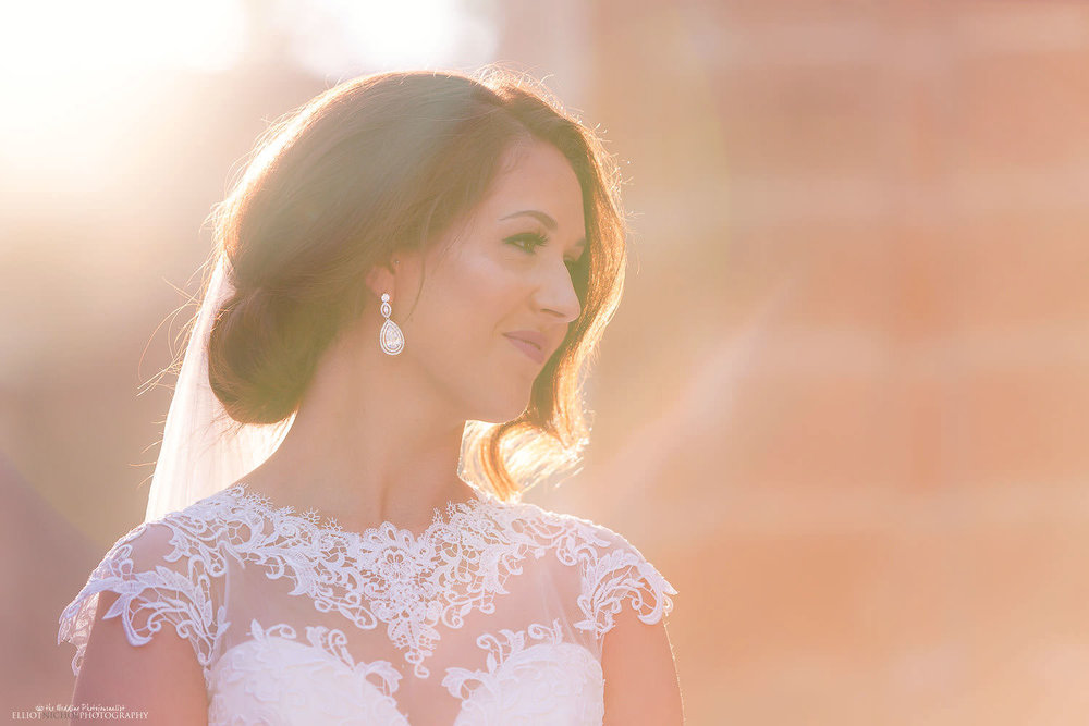 Candid photo of bride bathed in golden sunlight.