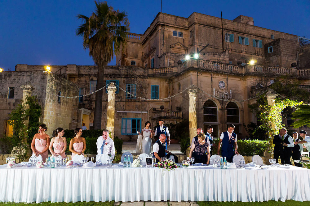 Bride and groom make their enterance to the head table for their wedding reception meal at Villa Bologna, Malta.