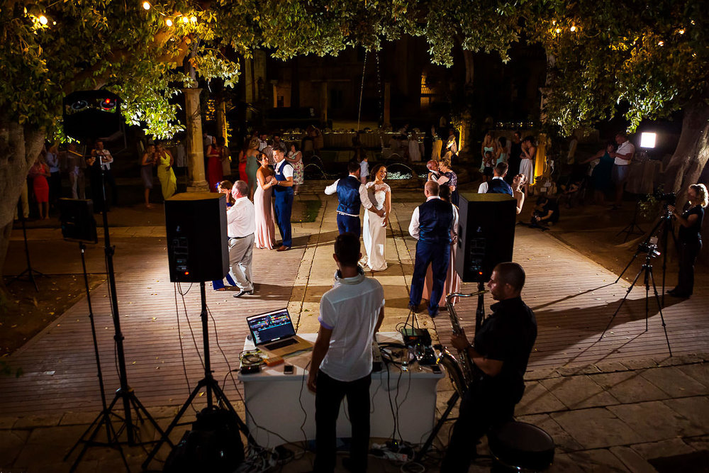 Wedding guests dancing in the gardens of Villa Bologna, Malta.