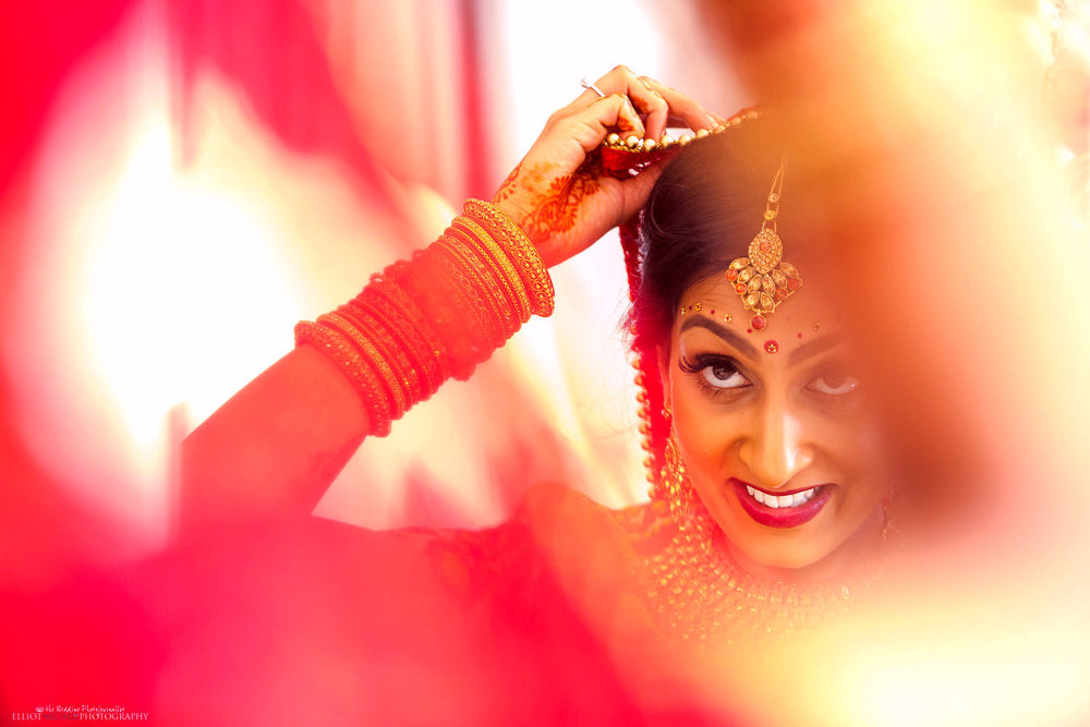 Indian bride getting married at Chateau Impney, Droitwich Spa, England.