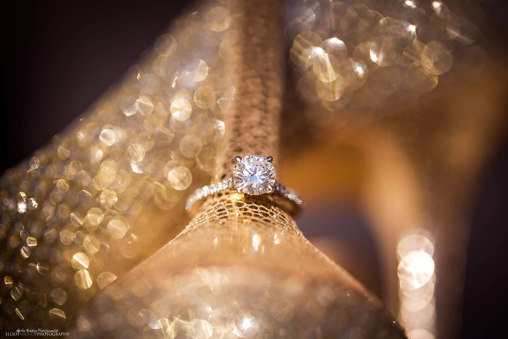 Engagement ring placed on the heel brides Jimmy Choo wedding shoes.