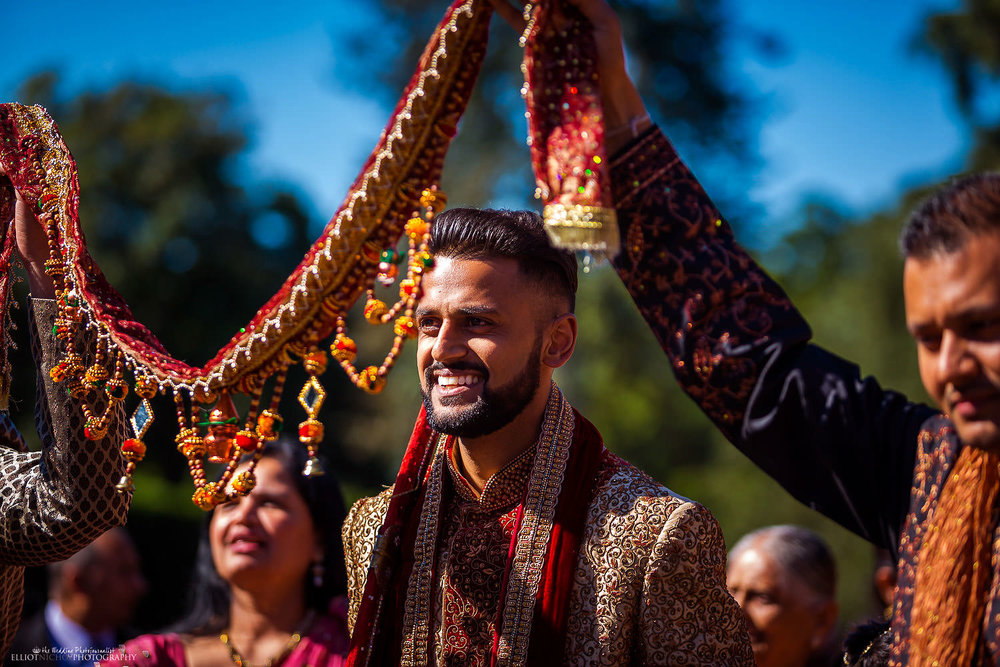 Indian groom walking to his wedding ceremony