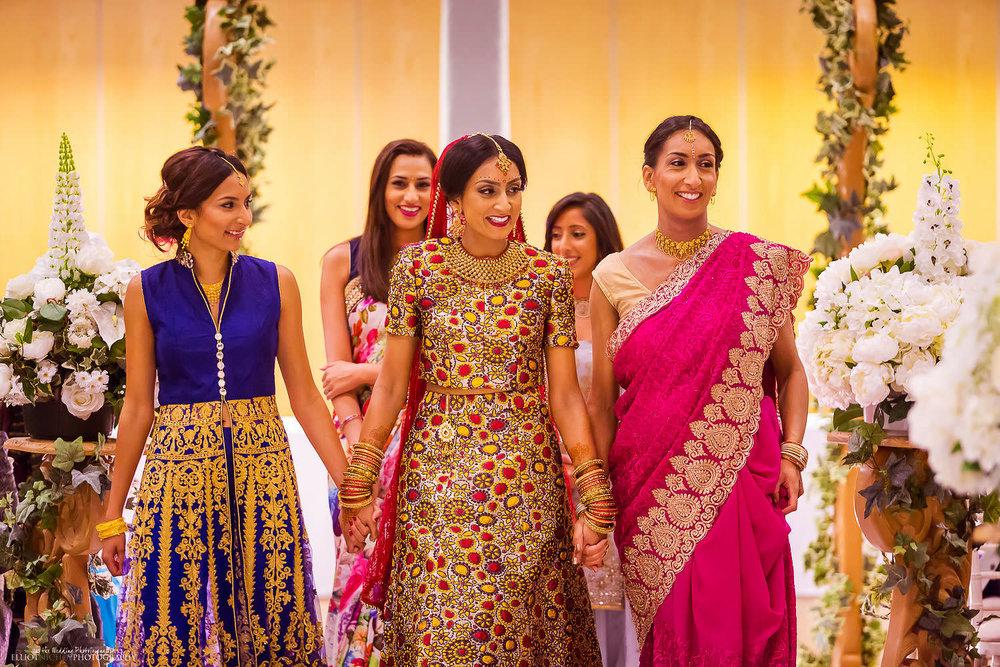 Bride enters the Hindu wedding ceremony. Photo by Newcastle Upon Tyne based wedding photojournalist Elliot Nichol.