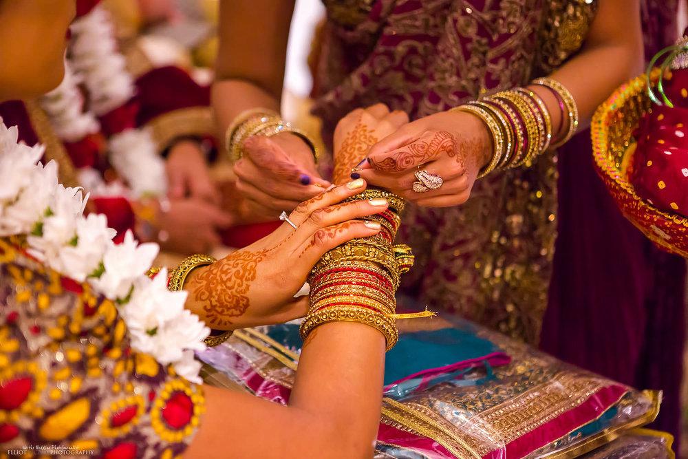 Indian bride receives jewellery during the Hindu wedding ceremony. Photo by Newcastle Upon Tyne based wedding photojournalist Elliot Nichol.