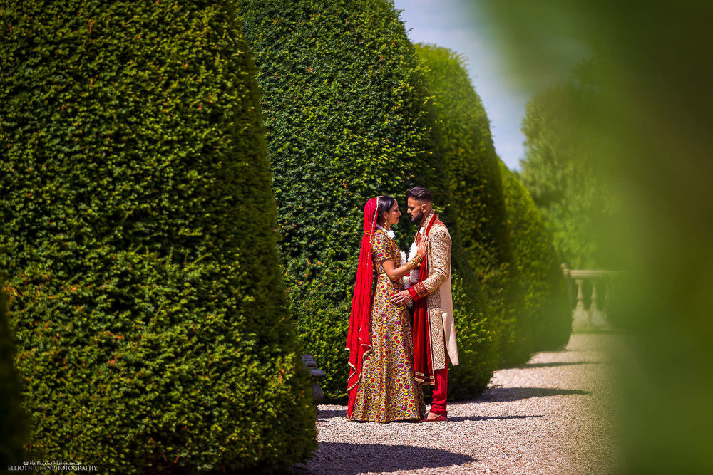 Portrait of the Bride and Groom after their Indian Hindu wedding ceremony at Chateau Impney. Photo by Newcastle Upon Tyne based wedding photojournalist Elliot Nichol.