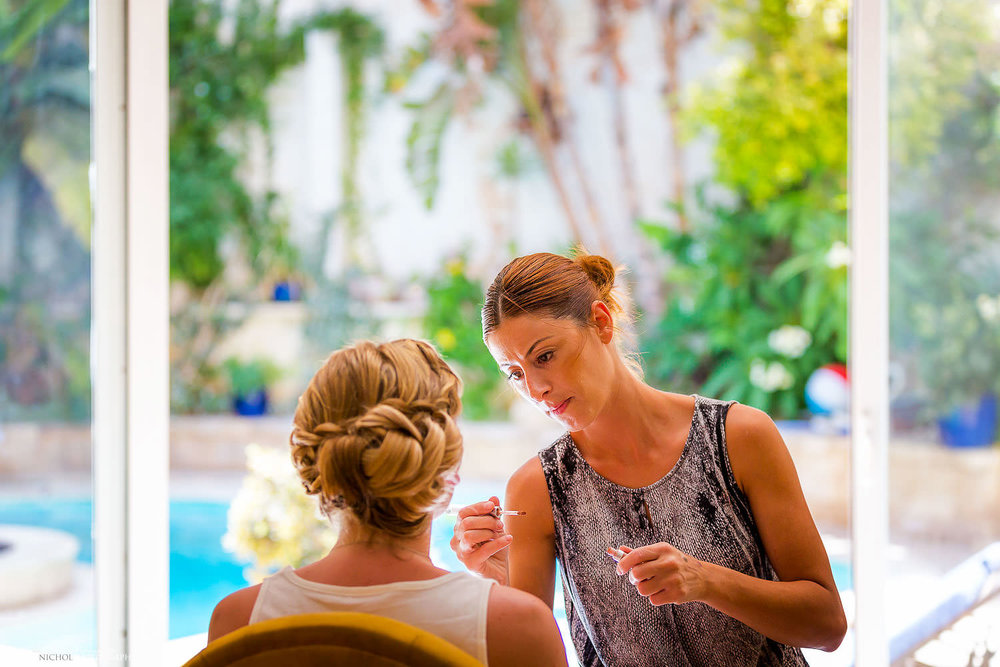 Destination bride with her makeup artist in Malta.