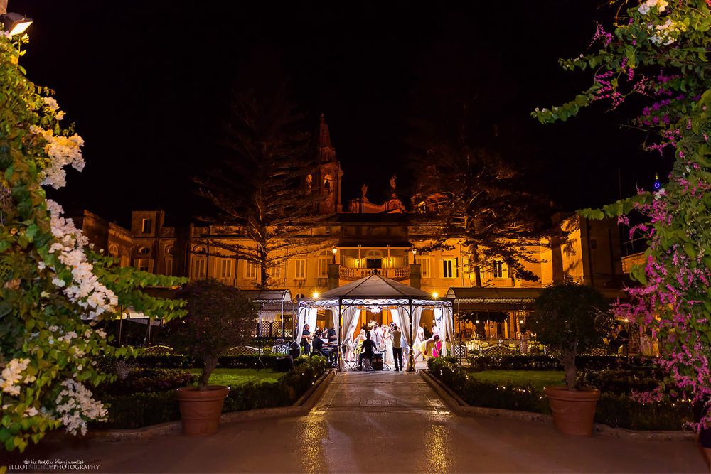 Night time wedding reception in the gardens of the Palazzo Parisio, Malta.