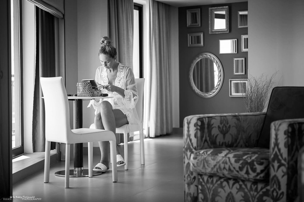Bride getting ready on her wedding day in her hotel suite at the Palace Hotel in Sliema, Malta.