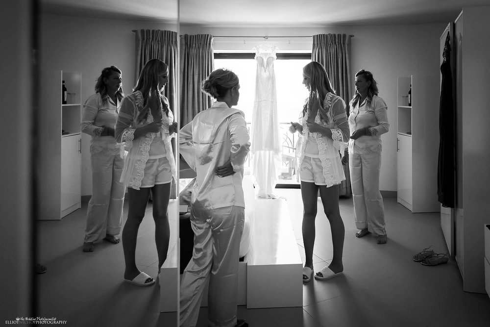 Destination Bride with her bridal party getting ready for the wedding in their hotel suite at the Palace Hotel in Sliema, Malta.