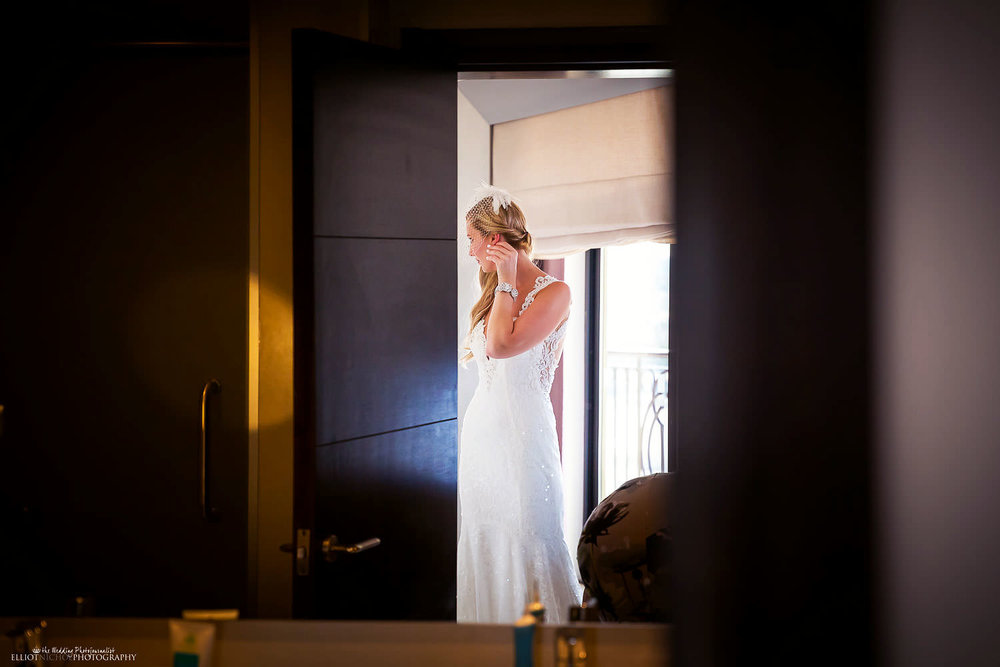 Bride getting ready in her room at the Palace Hotel in Sliema, Malta.