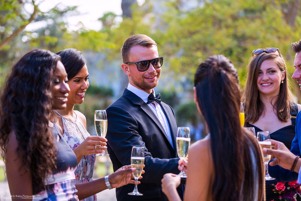 Wedding guest arrive and enjoy champagne in the Baroque garden of Villa Bologna.