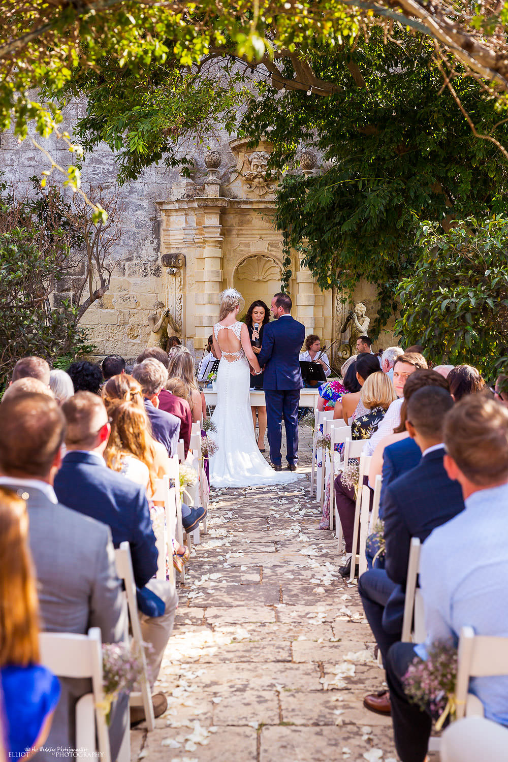 Destination wedding ceremony within the Baroque gardens at Villa Bologna, Malta.
