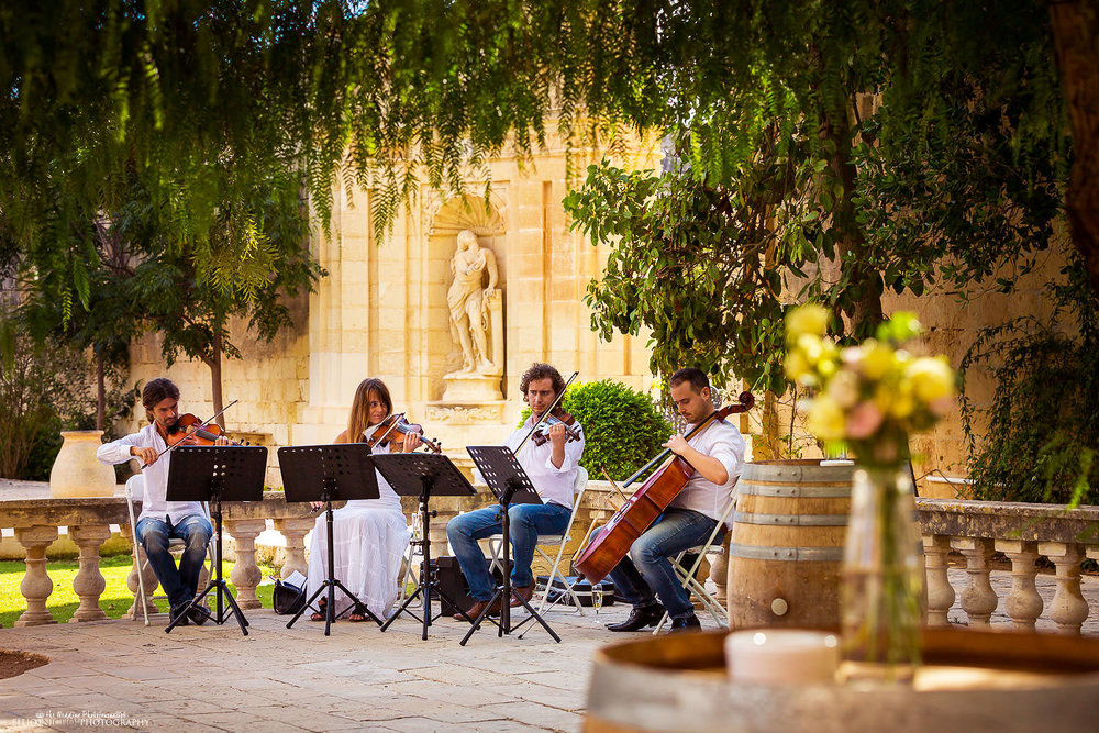 Musicians playing in the gardens of the Villa Bologna during the wedding reception.