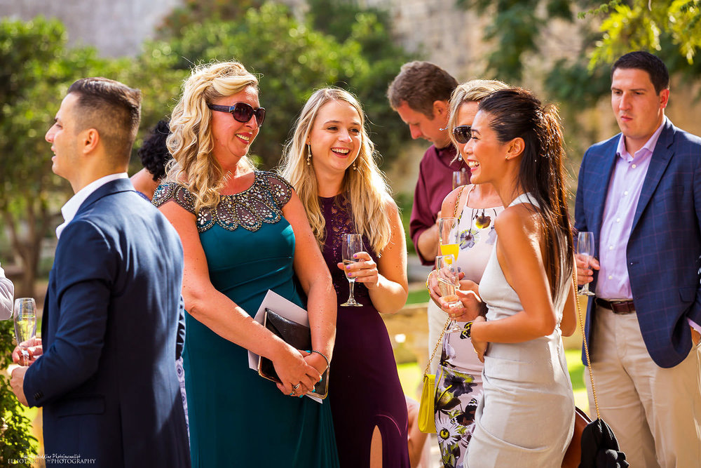 wedding guests in the Baroque gardens of Villa Bologna. Malta