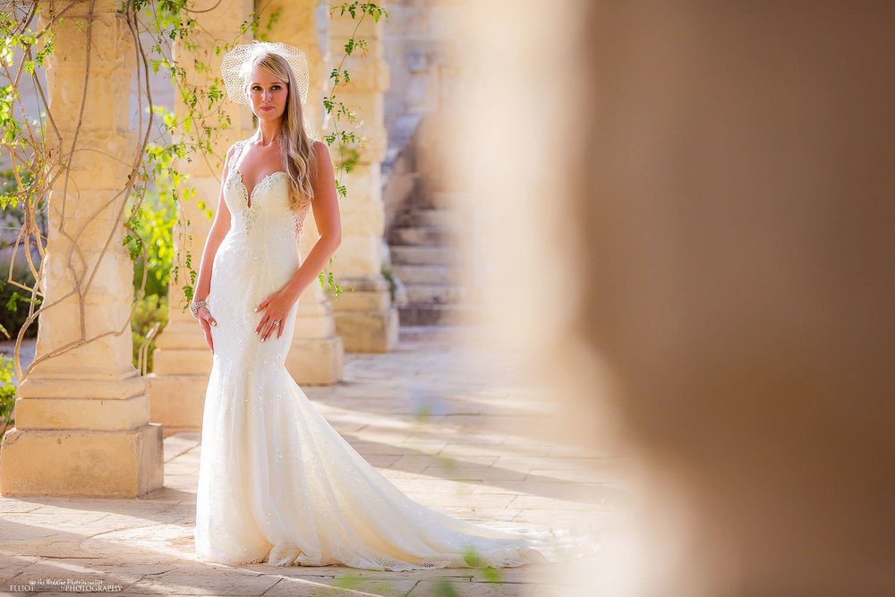 Portrait of the beautiful destination bride in the gardens of the wedding venue, Villa Bologna, Malta.