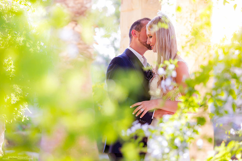 Bride and groom within the gardens of thier destaintion wedding venue in Malta, Villa Bologna.