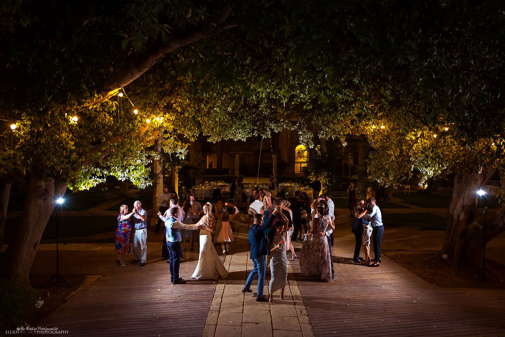 Wedding reception - wedding guests on the garden dance floor at Villa Bologna, Malta.
