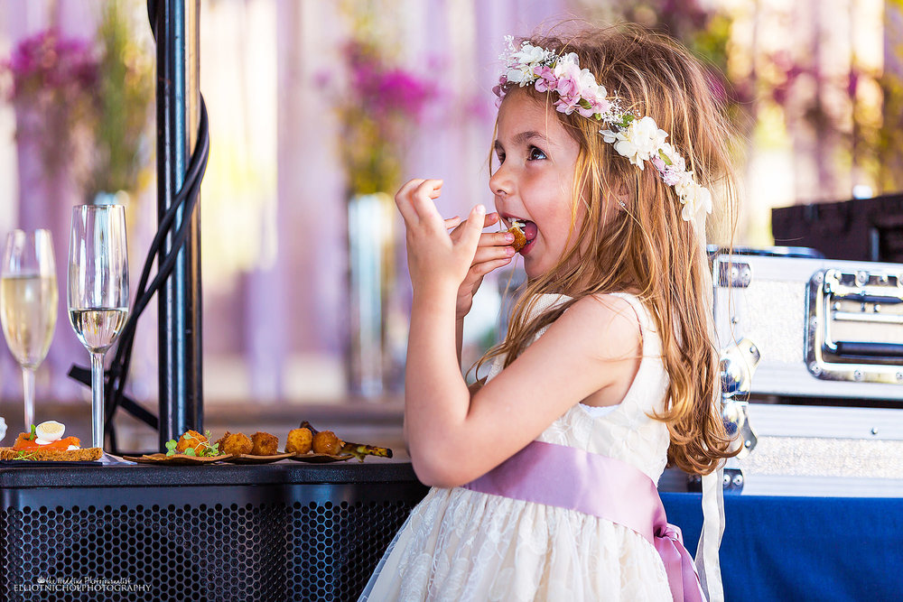 Flowergirl-enjoying-wedding-food-reception