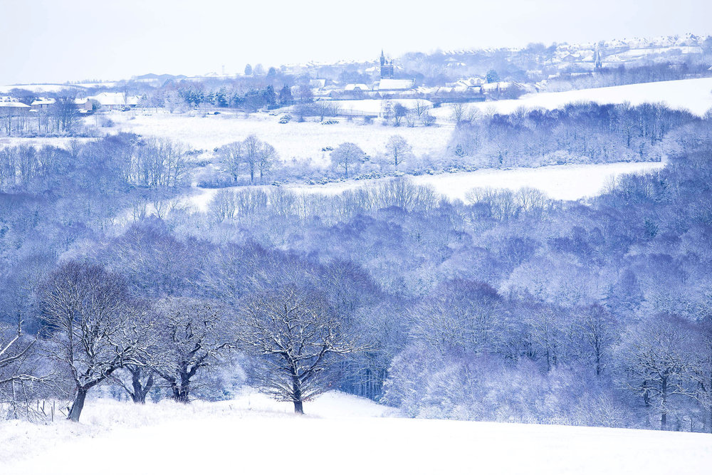 Beautiful Northumbrerland countryside with a fresh blanket of snow. Winter wedding photography.