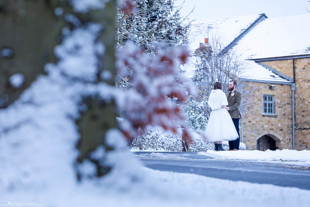 Newlyweds on the grounds of Derwent Manor, enjoying being out in snow covered countryside..