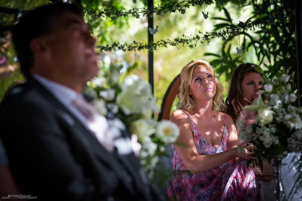 Wedding guests sitting watching the English garden wedding ceremony. North East Wedding Photography.