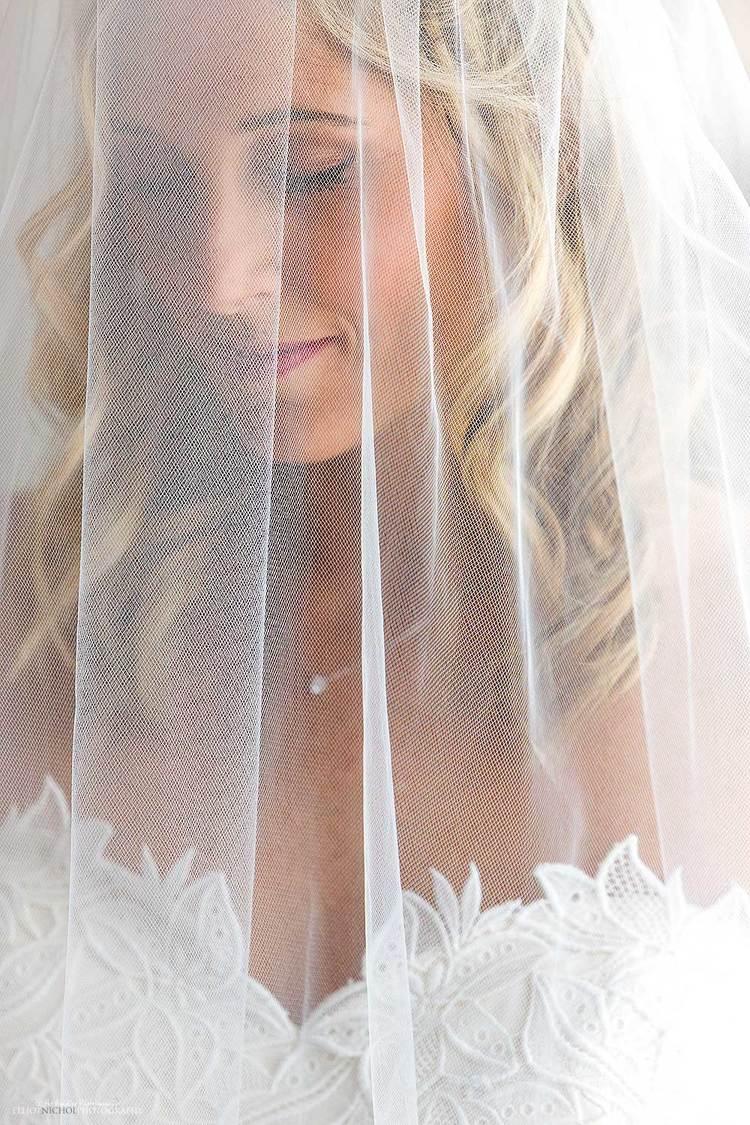 Northeast Bride in her wedding dress under her veil. Wedding Photography in Scotland.