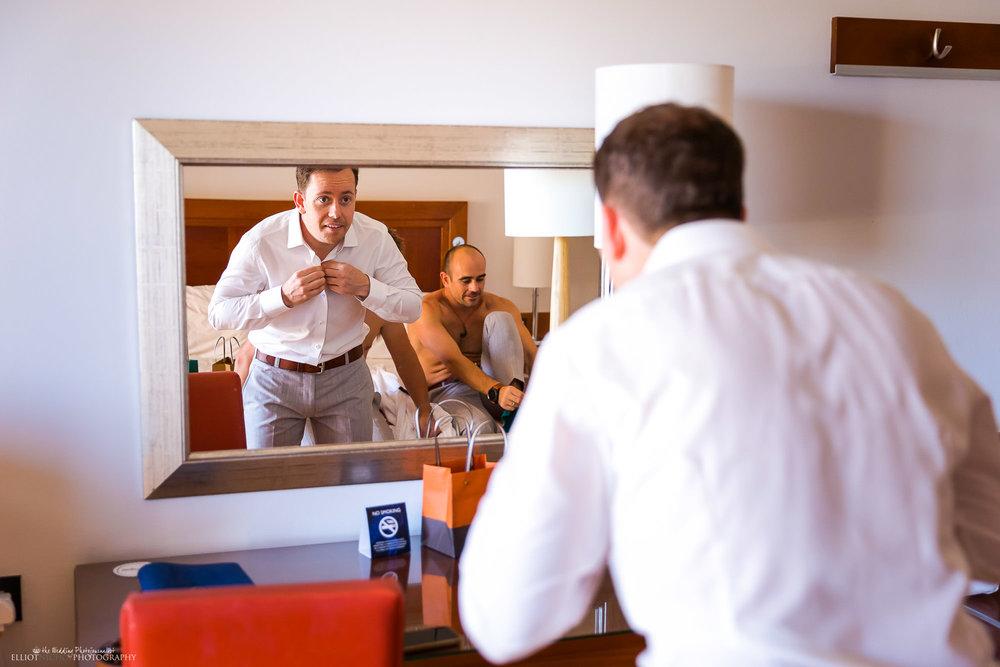 Groom-wedding-photography-getting-ready-hotel
