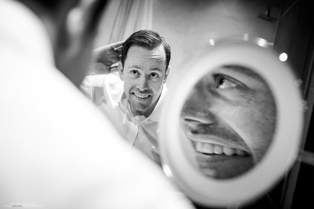 wedding-photography-groom-mirror-photographer-hotel-getting-ready