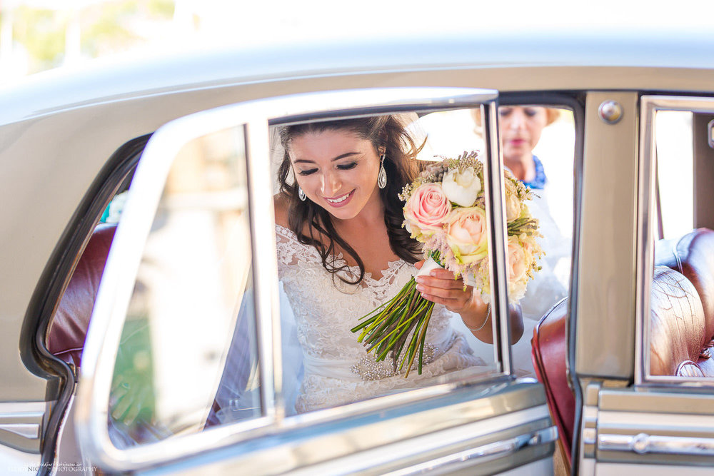 bride-car-arrives-church-destination-wedding-photography