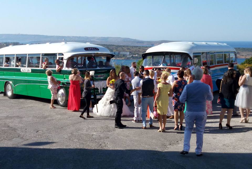 SUPRISE!! - We came accross this behind the scenes photo of us organising Klair & Russell's wedding groupshot from an online article on vintage Maltese buses.