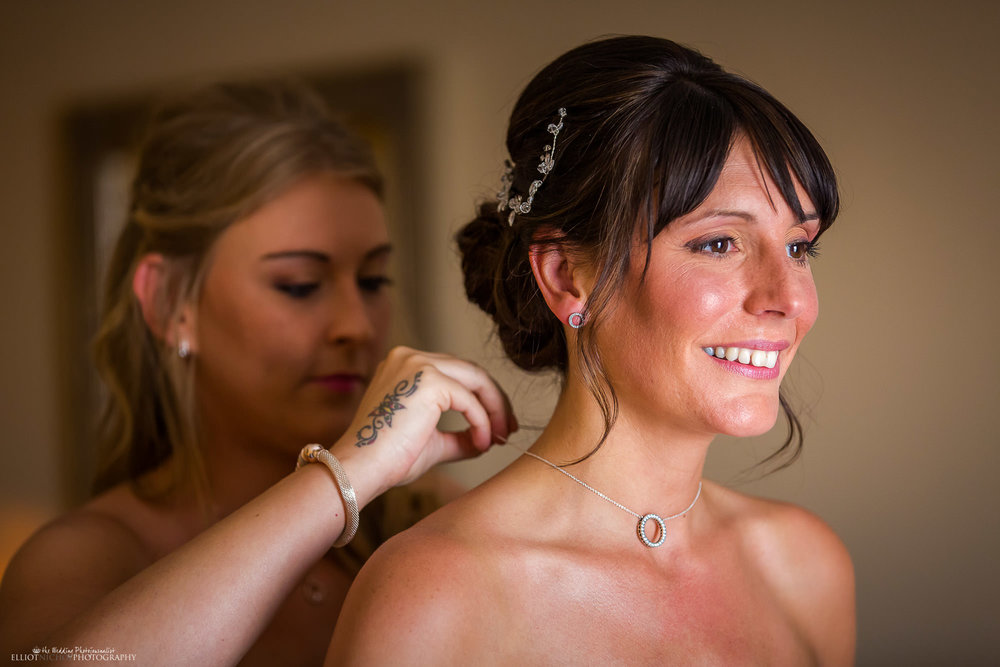 bride-necklace-getting-ready-wedding-day-bridesmaid