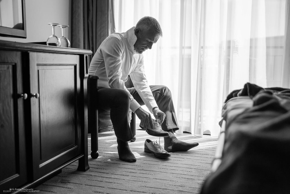 groom-getting-ready-destination-wedding-photographer