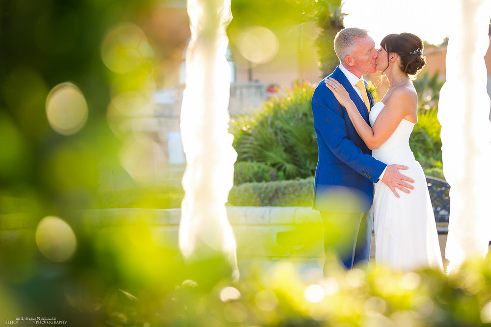 bride-groom-newlyweds-kissing-wedding-photographer
