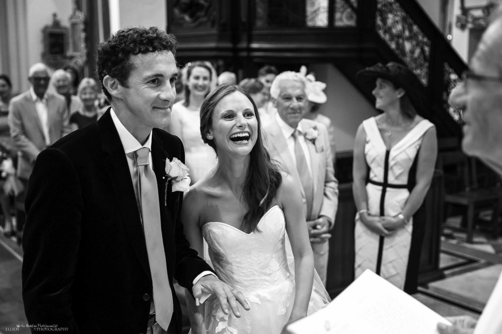 wedding-bride-groom-laughing-church-photography